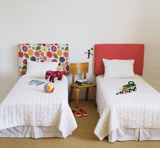 Until now, we had all sorts of bedrooms but not a single children's bedroom. This project features two small beds with  two fantastic looking headboards. A really bold color and pattern animates the place, making the kid's room playful, catching their attention and interest.{found on glanceatbeauty}.