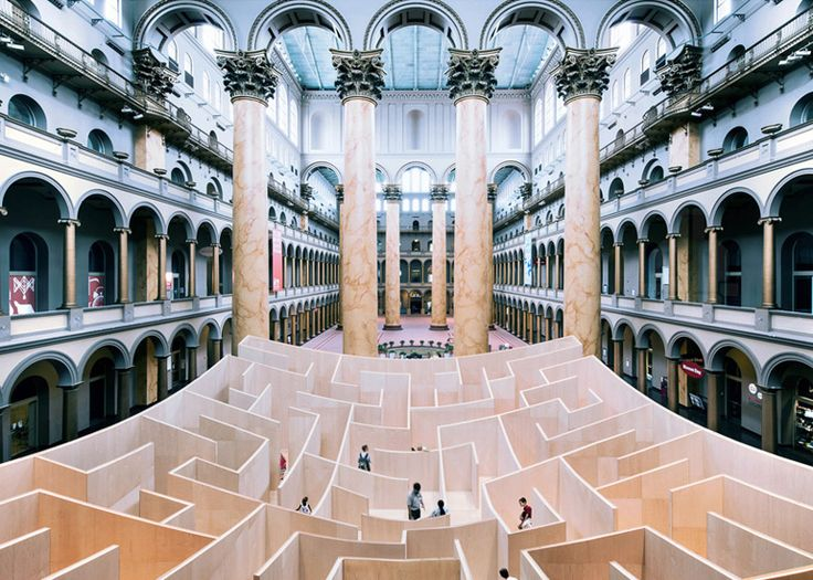 Visitors to the National Building Museum in Washington DC can now get lost inside a concave wooden maze installed by Danish architecture firm BIG.