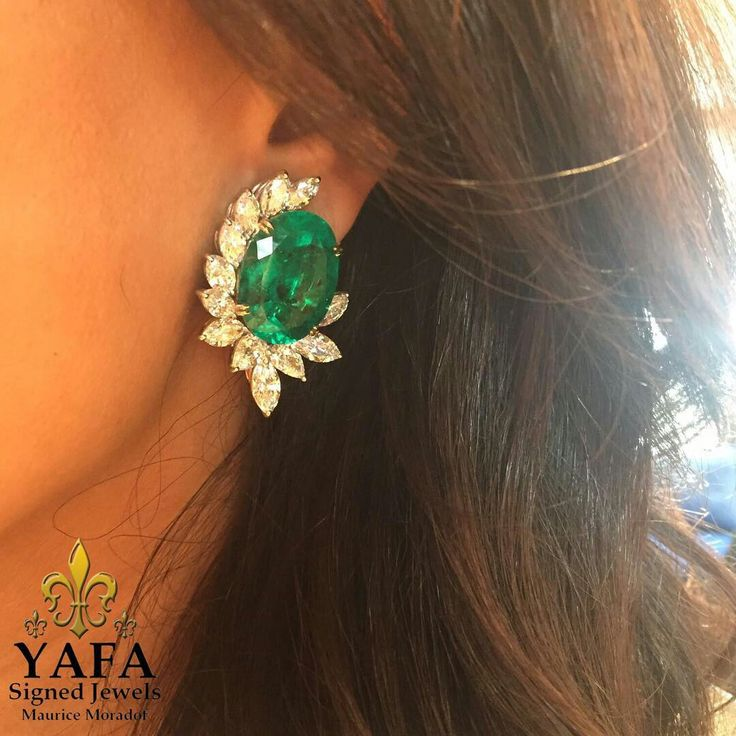 The perfect earring! A beautiful oval emerald is surrounded by marquise diamonds. www.vintagesignedjewels.com