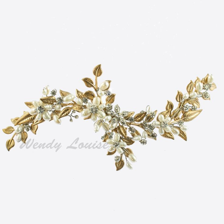 This hand gilded Jasmine vine piece/with comb is part of theexclusiveWendy Louise 'Gilded Garden' collection.This is a couture handmade 'made to order' piece and upon ordering will take between 4 - 5 to craft.Once the order is paid for in full, there is no cancellation, refund or return, as the order is final upon payment, as work will commence.Lay-by payments must be paid it full before work can commence on this designer piece.Measurement: 17cm long x 8cm at the widest part.This piece…