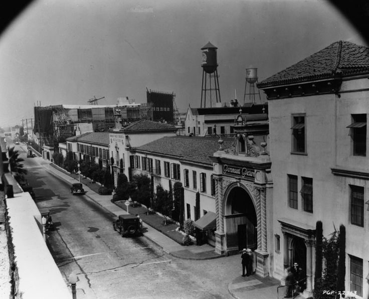 1936 - Exterior view of one of the entrance gates for Paramount Studios, located 5555 Melrose Avenue in Hollywood. The entrance to the studios' corporate office building is at center-left.