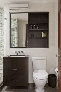 mirrormed cabinet over both vanity and toilet for great storage central park west renovation contemporary bathroom new york lauren rubin - Bathroom Remodeling Nyc