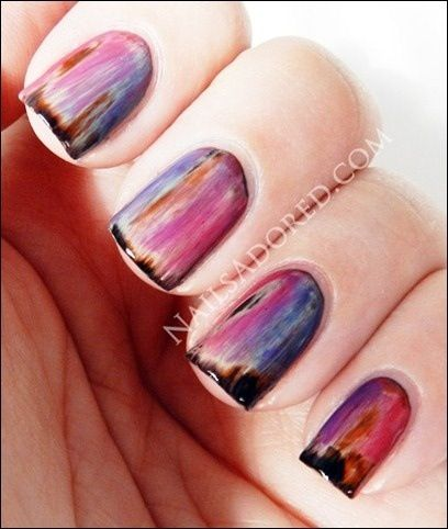 Paint with many layers of different colored polish. Let dry. Take cotton ball soaked in acetone & rub over to take off a couple layers. Top with clear coat.