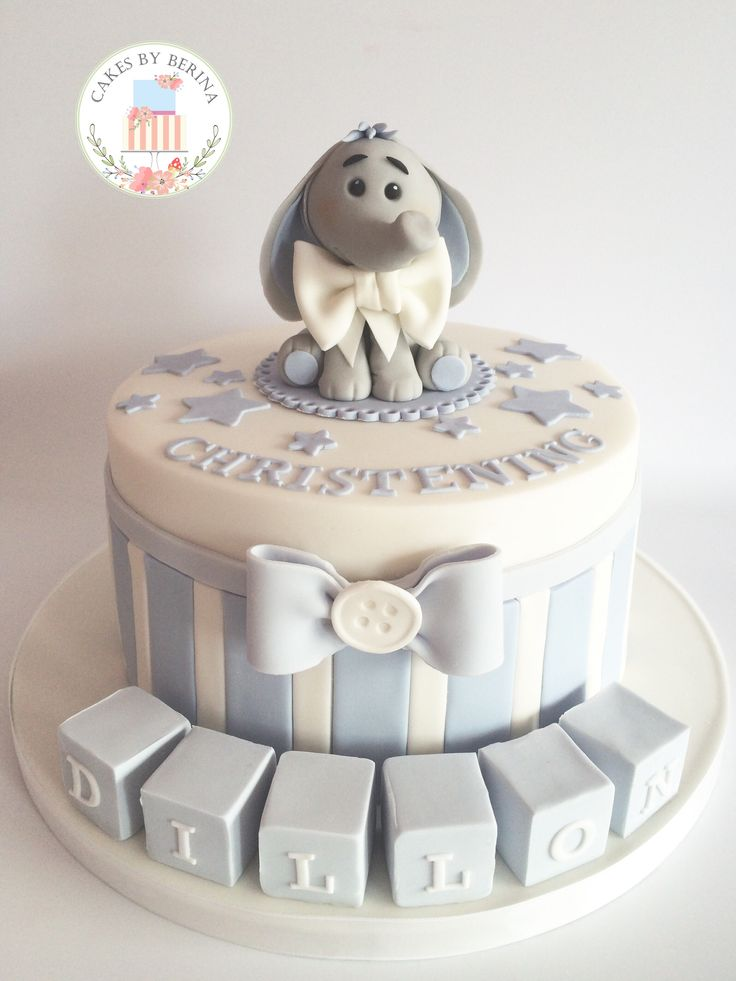 Cute baby boy blue christening cake with adorable edible elephant cake topper