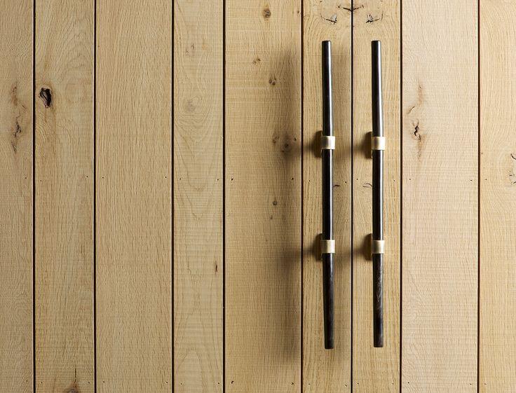 Handles detail of an Inglis Hall pantry or larder. Sawn oak and handmade handles by metal worked Ged Kennett.