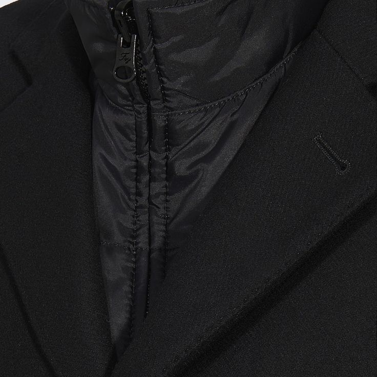 A functional and iconic coat, characterized by a removable inner vest.