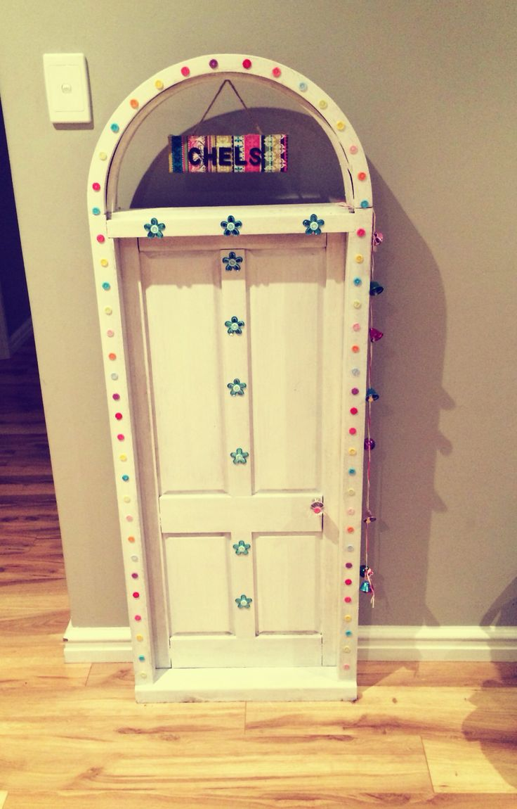 I decorated this kids size door for Chelsea's Fairy 3rd birthday