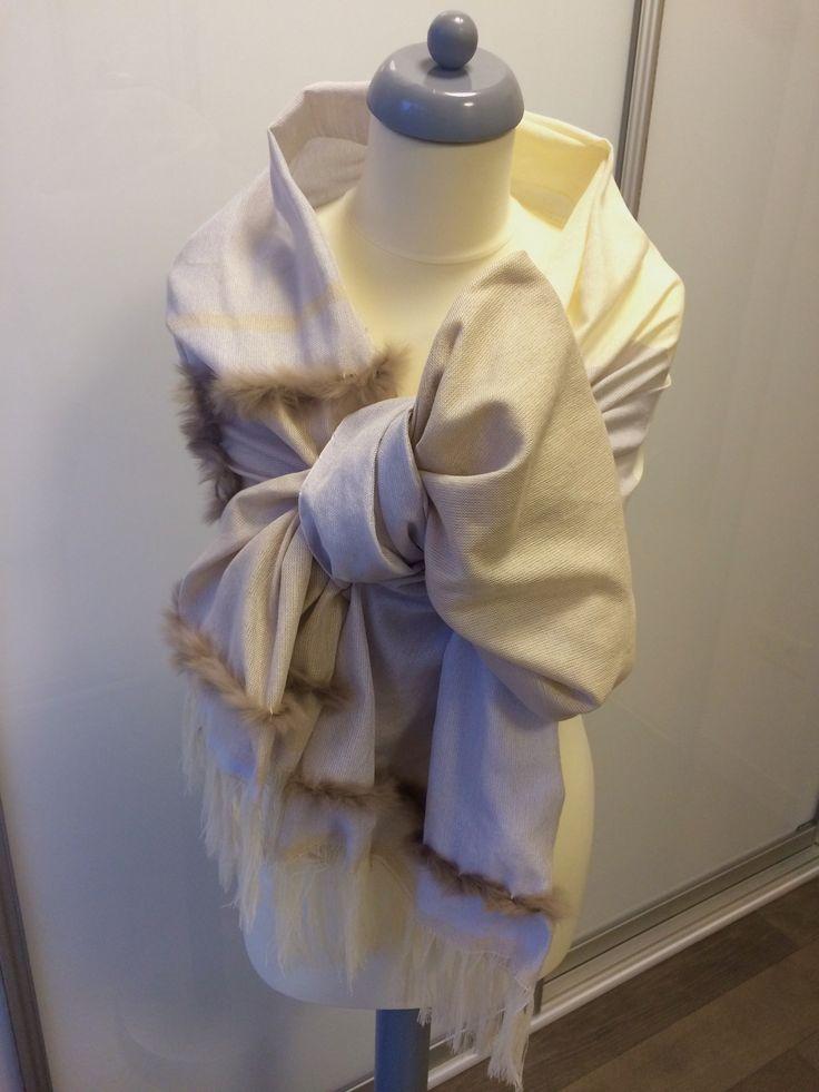 Hand-woven stole in mulberry silk and rabbit fur yarn. Designed by Bernadett Buda Medios.