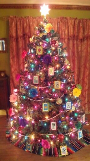 Loteria themed Christmas tree. Decorated loteria cards and tin ornaments. Tissue paper flowers. Tree skirt is a Mexican zarape. ~glo :)