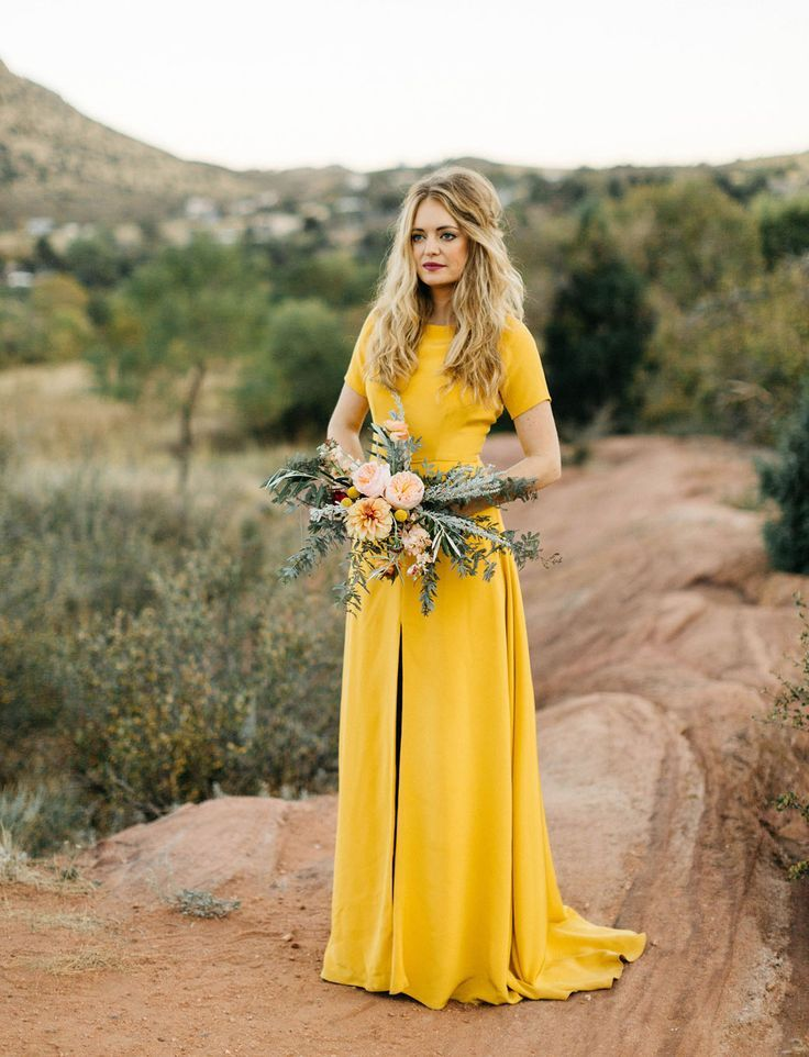 We adore this Sarah Seven yellow wedding dress for the bride-to-be at a fall wedding.  If you showcase yellow, your bridesmaids can wear white or neutrals to make you stand out!  Breathtaking.