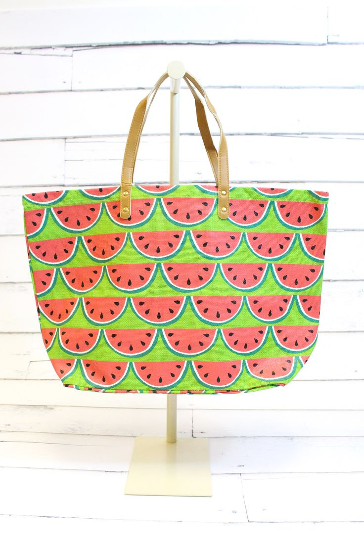 """Jute tote features all-over fruit print with vegan leather handles. Laminated wipe-clean interior and interior pocket. Dimensions: 16"""" x 24"""" x 9"""" All sales final on accessories."""