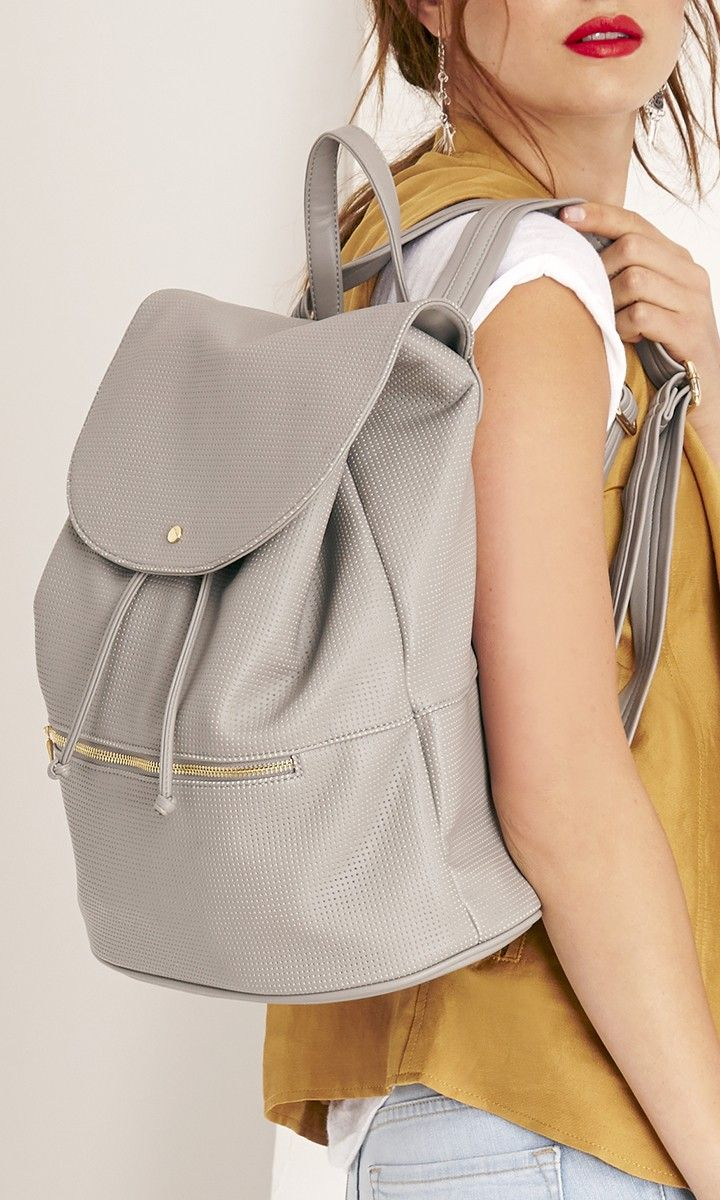 Grey perforated backpack made from buttery soft vegan leather