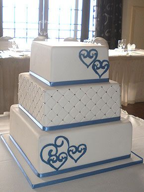 cornflower blue wedding cakes | lovely fresh white three tiered square cake. Embossed with a quilted ...