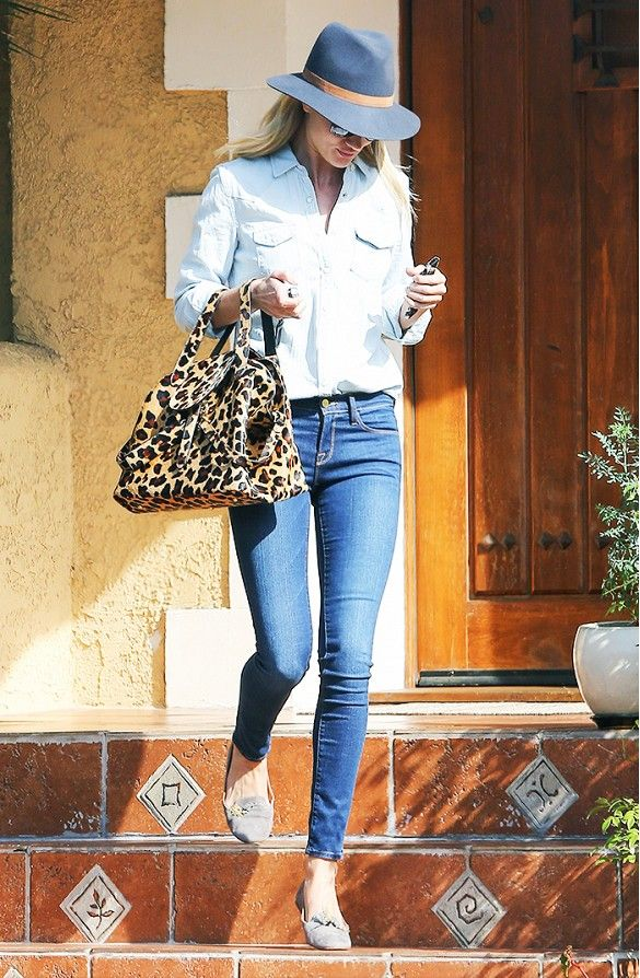 Rosie Huntington-Whiteley in a button-down blouse, skinny jeans, a leopard bag, flats, and a Janessa Leone hat