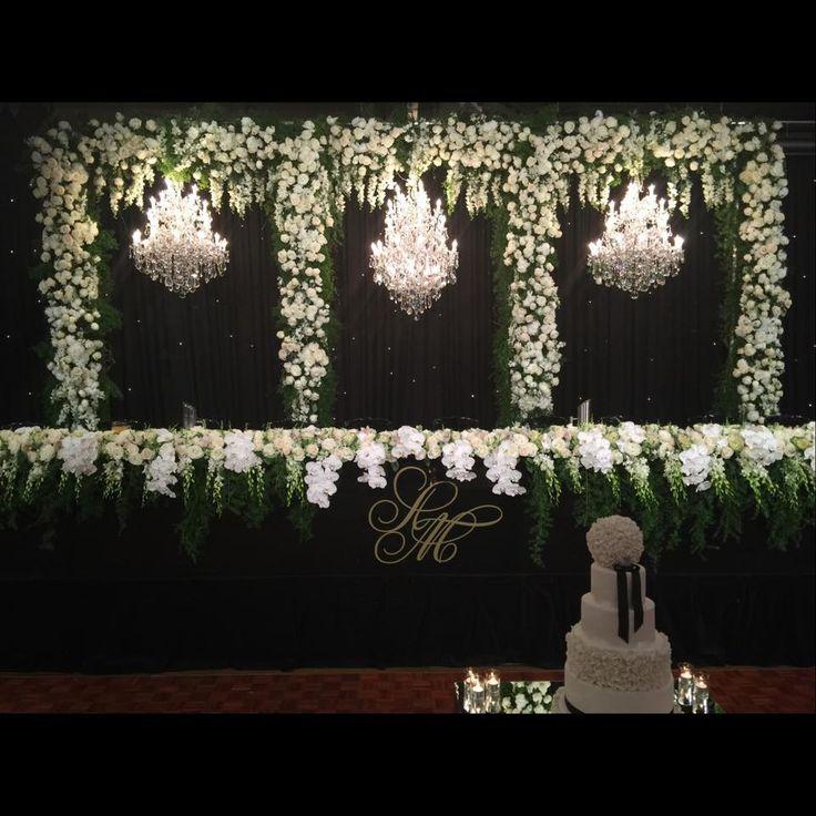 Wedding reception head table. Chandelier