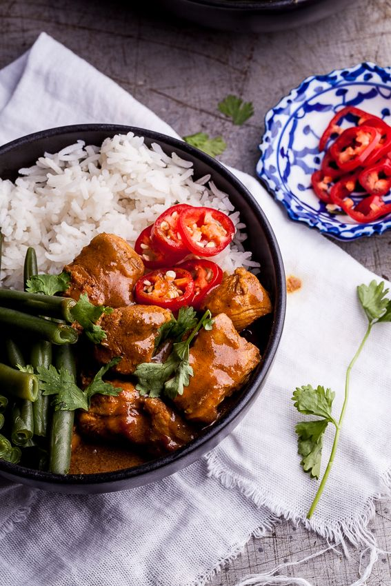 Aromatic chicken curry served with cardamom Basmati rice, a simple tomato and onion salsa and lots of fresh chillies makes a perfect weeknight meal.