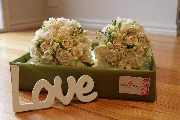 Ivory roses, with white freesias & berzellia #weddings  www.RedEarthFlowers.com.au