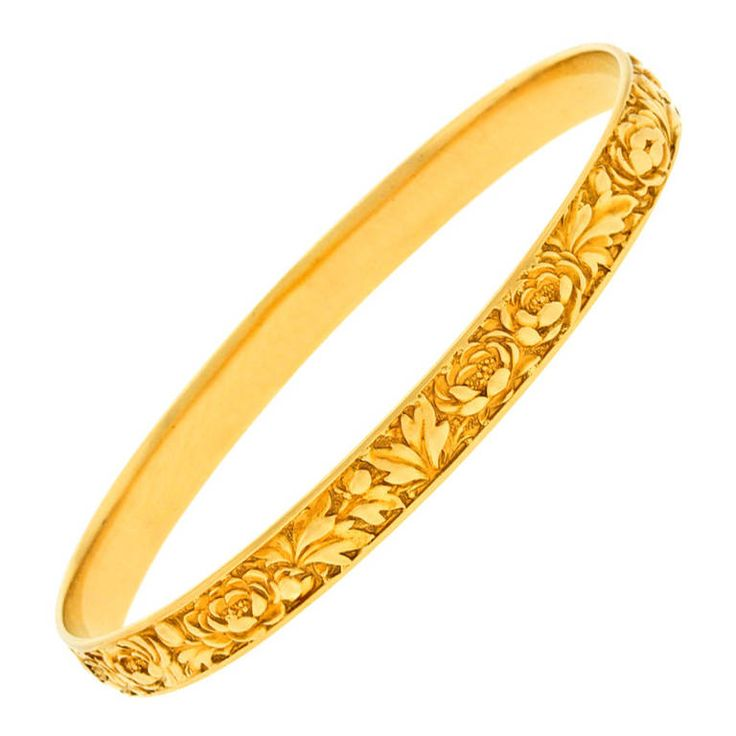 Tiffany & Co. Antique Gold Bangle Bracelet. Circa 1910, 18k, Tiffany & Co. Makers, New York. This beautiful yellow gold bangle bracelet by Tiffany is decorated in a profuse finely detailed floral motif. Redolent of the famous repousse patterns found on their silver, this look is classic, historic and tasteful. The delightful inscription lets us know that it was a family gift from 1912.