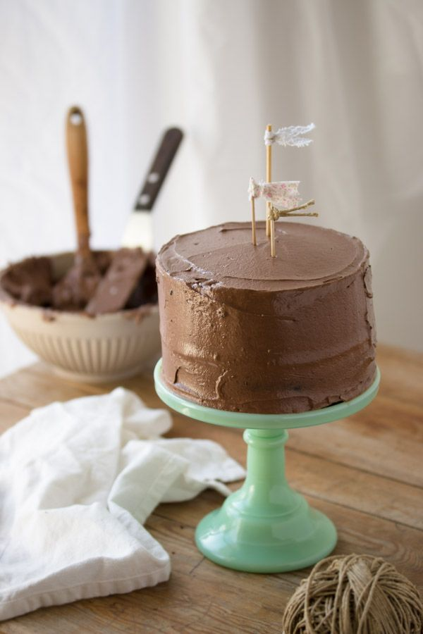 Chocolate Layer Cake Layered with a creamy fudge frosting, this easy-to-make cake is moist with a deep chocolate flavor. My favorite choice for a classic celebration cake!
