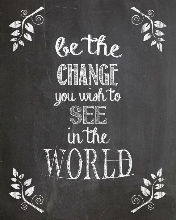 """Beautiful chalkboard art showcasing the quote """"Be the change you wish to see in the world"""", which is commonly attributed to Mahatma Gandhi."""