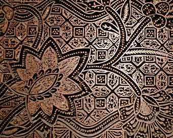 Malaysia 'batik cap,' or block-waxed batik. Stamped batik has been produced in Malaysia since at least the 15th C. Originally, Malays used potatoes and other natural materials as the 'block' to carve the batik design into. Nowadays, copper stamps are used.  Batik workshops and factories and home craft studios are found in most states in Malaysia, including  Langkawi, Kedah, Penang, Kelantan and Terengganu.