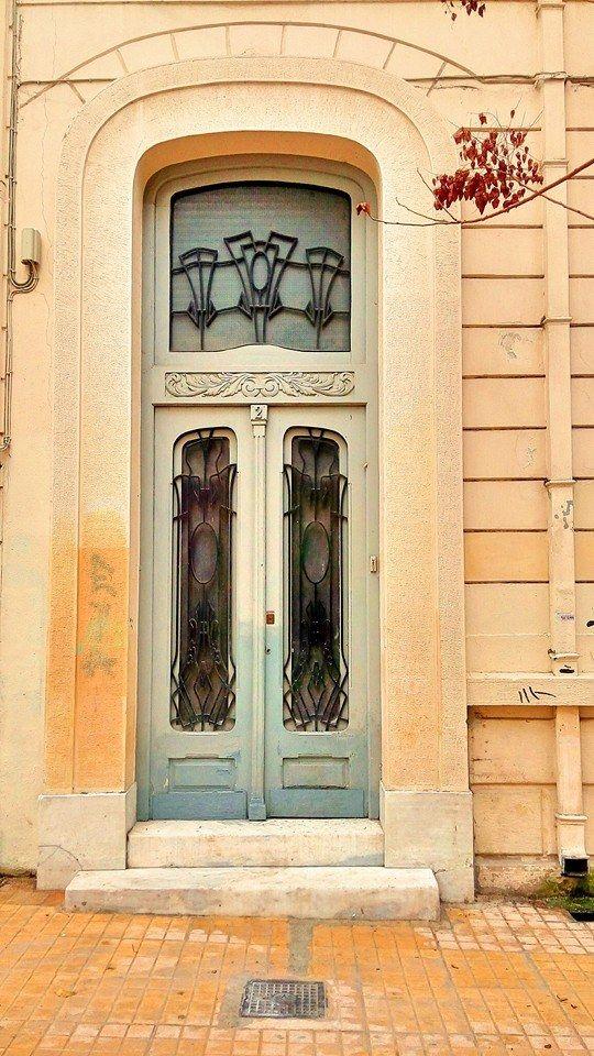 Αrt deco entrance door at Ag.Panteleimona, Athens via Athensville.