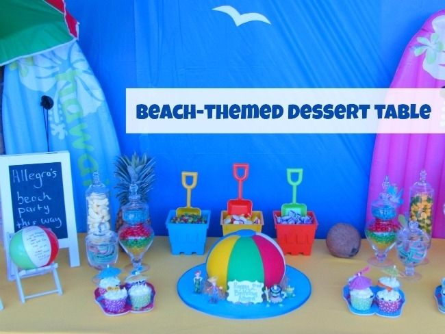 Boy or girl birthday party- pool party theme Beach ball birthday cake, sand pails to hold candy with shovels for candy scoops, inflatable balls as invites... Spaceships and Laser Beams kids birthday party ideas summer-beach-pool-dessert-table-birthday-party