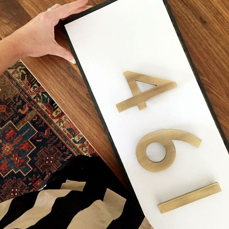 For a quick update to your home's exterior, try this DIY modern traditional house number plaque from Chris Loves Julia.