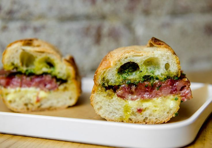 Corkbuzz's cotechino sausage sandwich: Eating one (or more) of these sandwiches is a great way to congratulate yourself for making the aioli from scratch!
