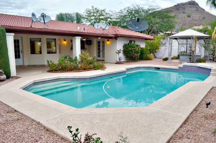 This HomePath property has nice mountain views... check out the great backyard with extended covered patio, pool, and large gazebo.