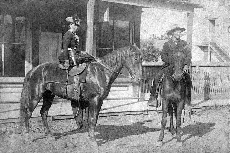 Belle Starr, sitting sidesaddle staring intently at one of the Roeder brothers, photographers in Fort Smith, Arkansas.  She is wearing a single loop holster with a pearl-handled revolver, with a riding crop and is wearing leather gloves.  This was taken in 1886, about three years before her death in Indian Territory at the hands of an unknown shooter.