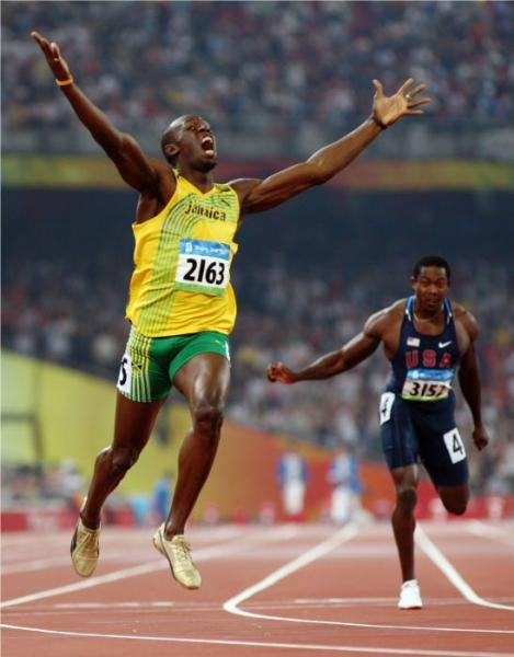 Usain Bolt Breaks 100-Meter World Record Twice. One year after topping the original record of 9.72 seconds with his time of 9.69 at the 2008 Beijing Olympics, Bolt beat his own record with a time of 9.58. He didn't just get the record, but he totally dogged it in the stretch, just coasting and prematurely celebrating while doing it.