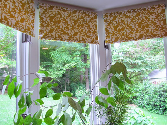 Fabric Covered Roller Shades:  easy project -- shades were cut to size at a local hardware store and then glued to fabric.