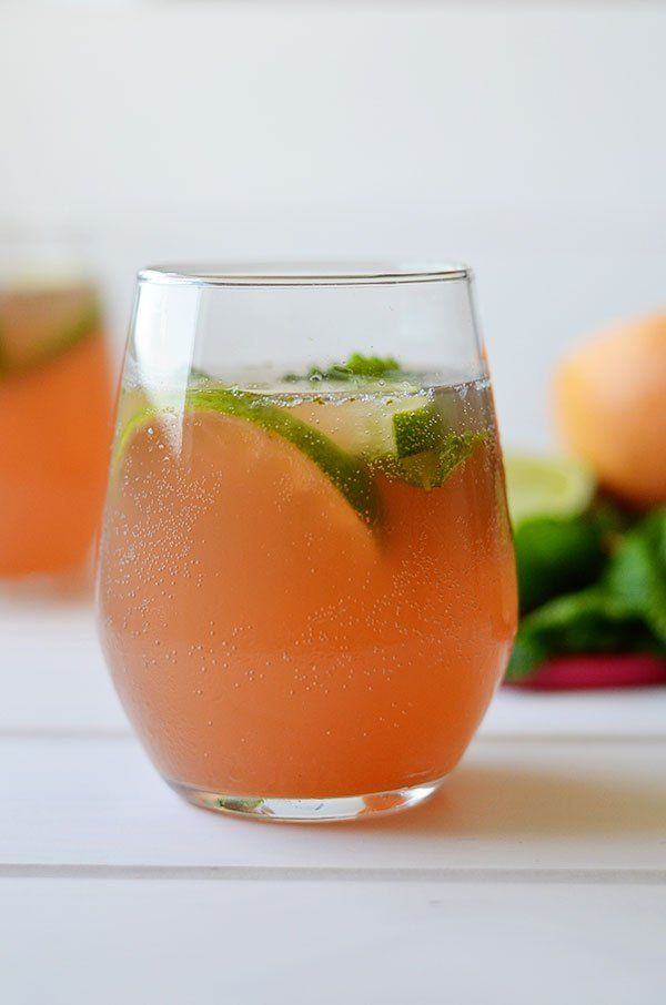 A refreshing combination of pink grapefruit, lime and mint. This Pink Grapefruit Virgin Mojito is sure to hit the spot this summer!