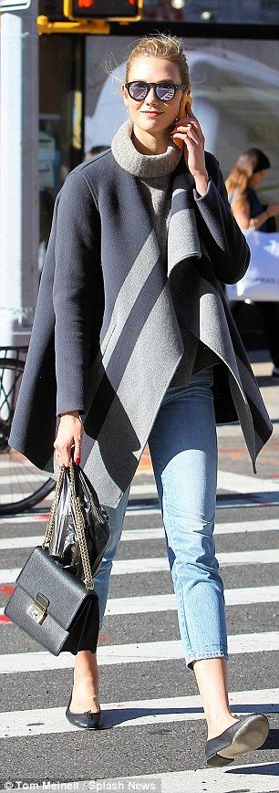 From day to night: Karlie was pictured earlier in the day dressed in a cool and casual ens...