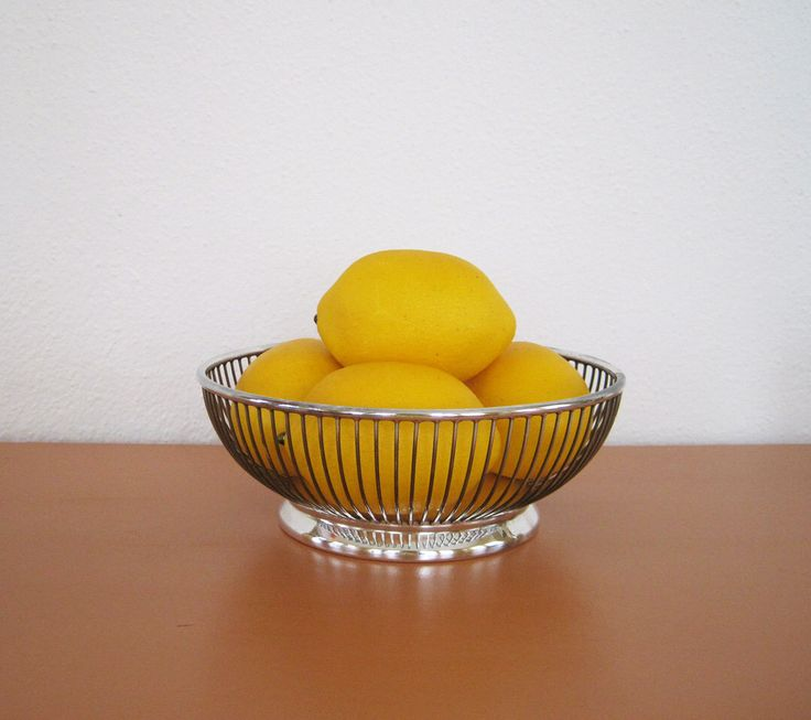 Mid Century Silver Plate Wire Bowl or Basket, Gorham Silver Plate by behindtheorangedoor on Etsy https://www.etsy.com/listing/167264685/mid-century-silver-plate-wire-bowl-or