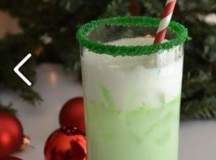 Grinch Spritzer Recipe ngredients  BY THE GLASS 1 part lime sherbert 1 part sprite or lemon/lime soda of your choice 1 part vodka green sugar for glass rim 1 lime