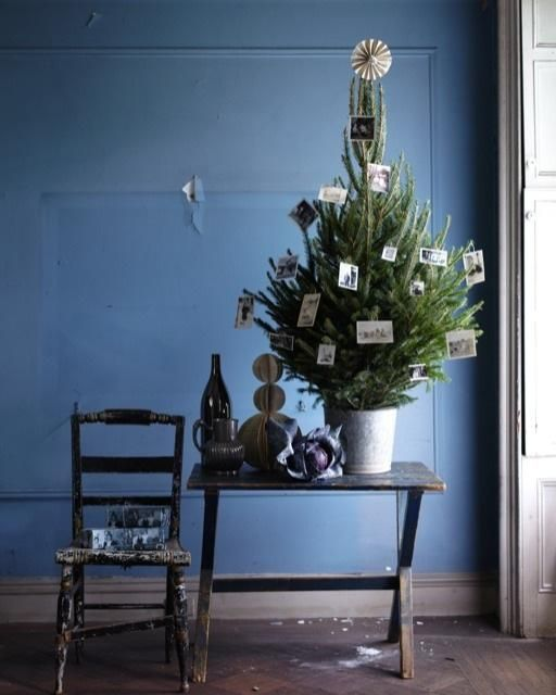Galvanized buckets with small trees and earthy ornaments or notes stuck into
