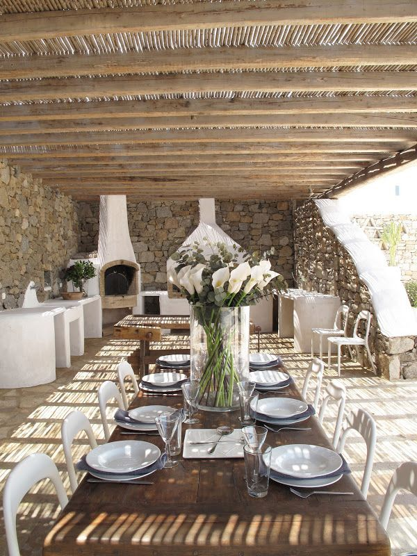 Outdoor bar and al fresco dining at Private Trade Winds Luxury Villas, Mykonos, Greece