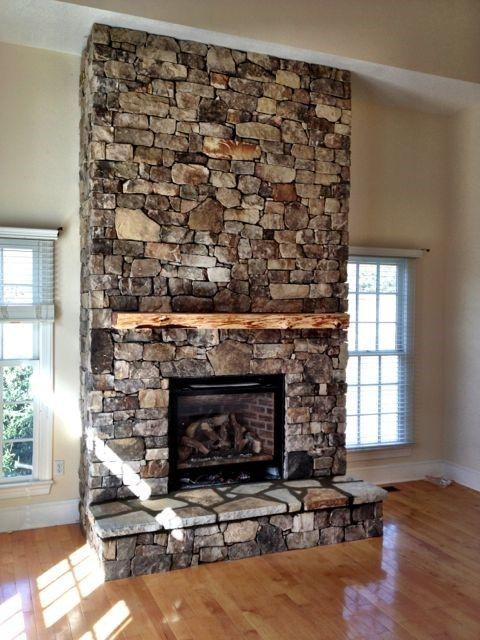 Flagstone chimney and natural wood mantel.