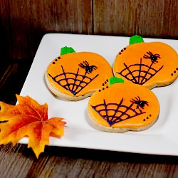 pumpkin spice cookie decorated for halloween