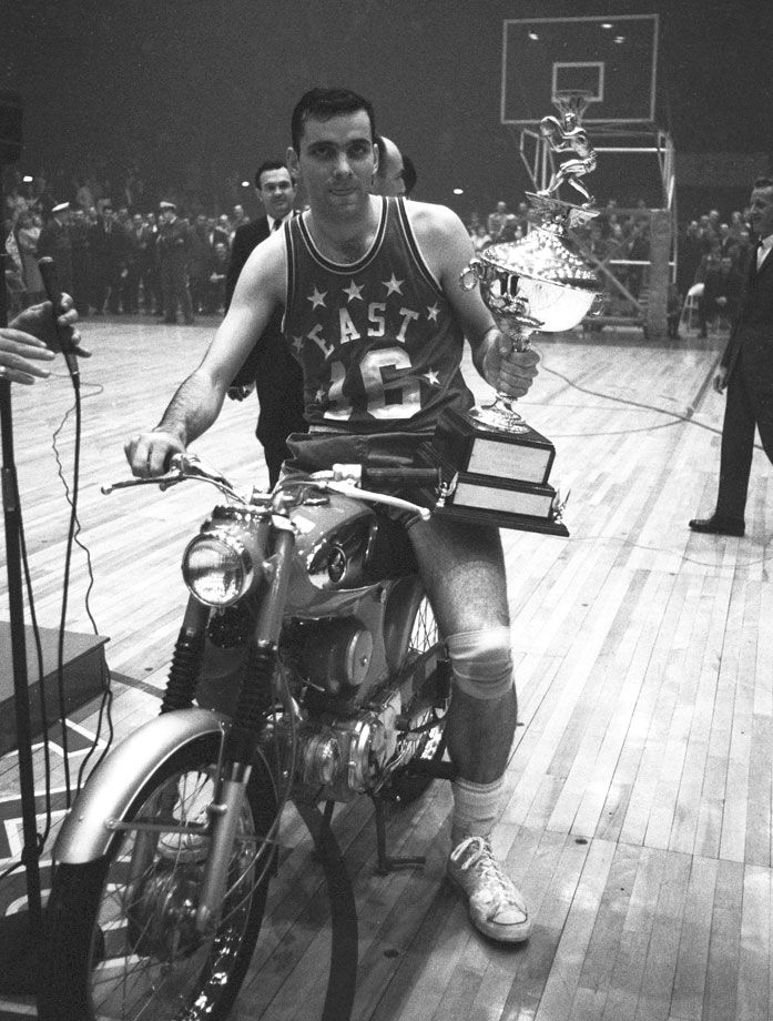 Jerry Lucas poses with the motorcycle and MVP trophygiven to him after the NBA All-Star Game on Jan. 13, 1965 at Kiel Auditorium in St. Louis. The 1963-64 Rookie of the Year, seven-time All-Star and Hall of Fame power forward turned 75 years old today. (Neil Leifer/SI)