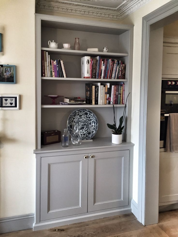 Bespoke fitted alcove unit, traditional dresser style, with book shelves and panelled door cupboards for a living room or dining room. MDF painted in light grey. Made by Oliver Hazael Bespoke Carpentry and Plastering in Bath, Somerset #alcove #storage #bookshelf #bookshelves #dresser #bespoke #Georgian #Victorian