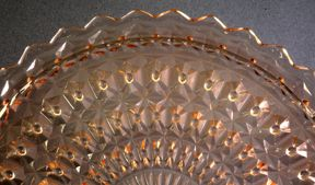 """Depression Glass Patterns Holiday Jeannette Glass Company - ca. 1947- mid-1950s   Also known as """"Buttons and Bows."""" Made in pink by a company associated with Depression glass, but it dates much later than other similar patterns. Most often found in pink, but a few pieces were made in crystal (clear) and iridescent.  The shapes used for this pattern are very similar to Jeannette's Depression-era Windsor pattern."""