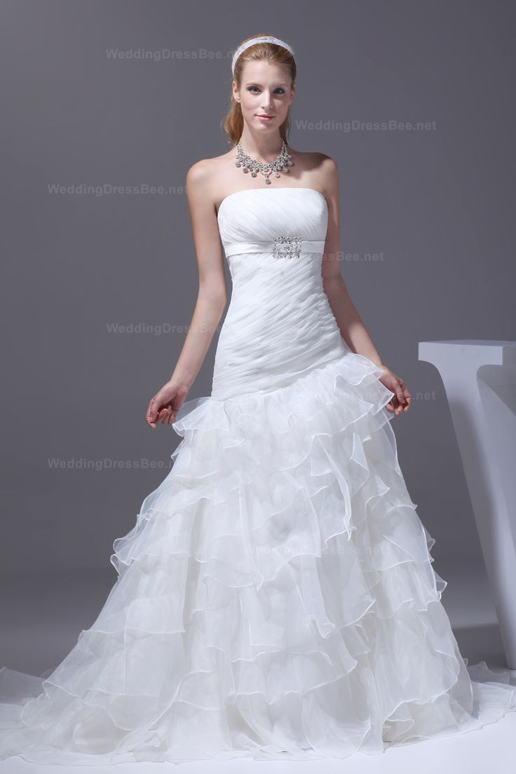 Strapless organza wedding dress with an asymmetrical dropped waist