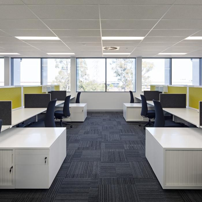 Toll | Tennyson, QLD. Designer: Arquis Design. Builder: FDC. UCI Supplied: Transform workstations with Zodiac screens, Custom reception joinery, Custom executive desks, Custom glass and stainless steel boardroom table, Cosmos tambour storage, Zeta pedestals and caddies, Baron and Scout task chairs and more. uci.com.au