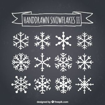Hand drawn snowflakes on blackboard More