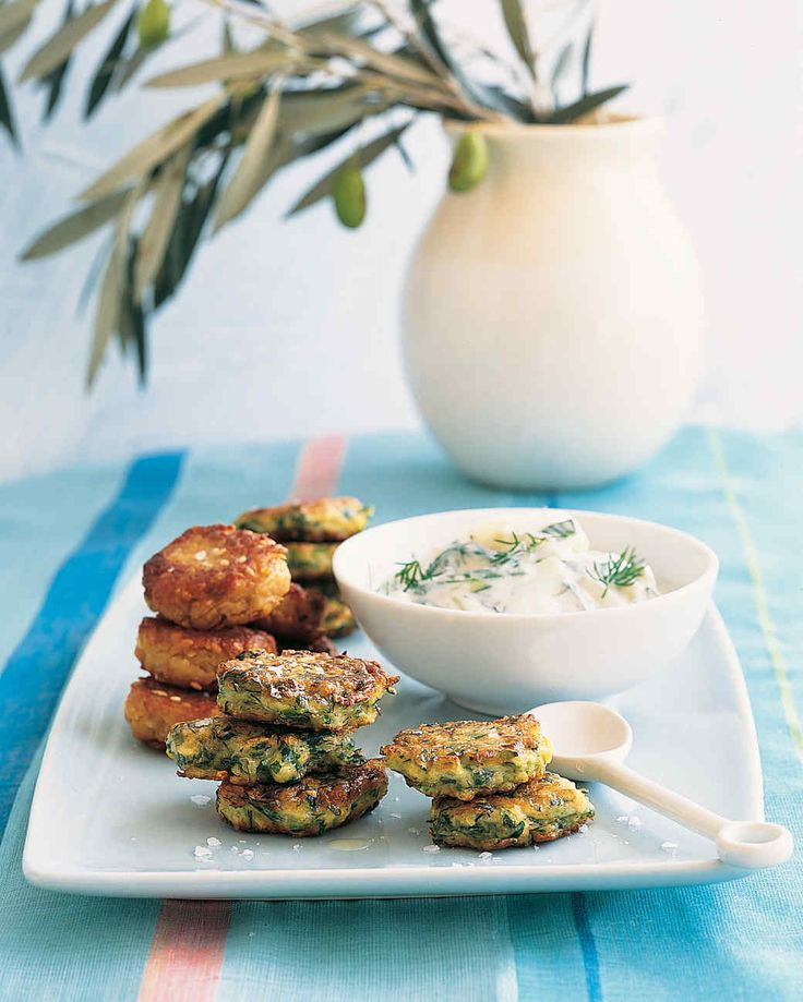 These crispy, savory fritters are presented with classic tzatziki, a garlicky yogurt sauce.