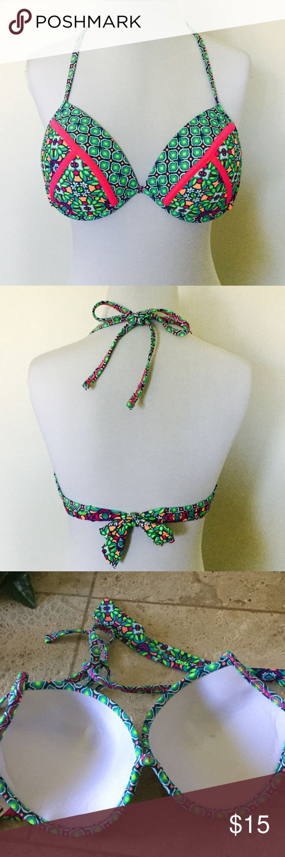 Push Up Bikini Top 💖 NWOT Super sexy n fun to wear to the beach or pool party. Does have a slight smudge from handling on the inside of the cup, but should come out with first wash. This has never been worn. It's in new condition. The colors are amazing in neon.. You'll love the design and look Swim Bikinis