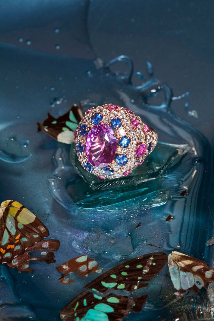 Graff ring, 6.82-carat oval pink sapphire with blue and pink sapphires and diamonds, price upon request, available at Graff New York, 710 Madison Ave.; (212) 355-9292.